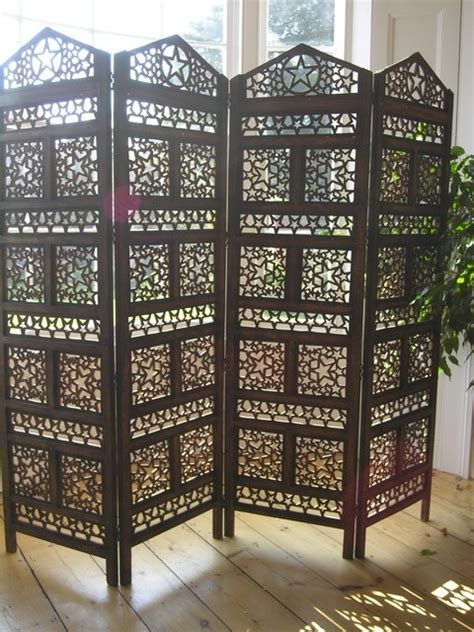 Indian carved wooden screen with 4 panels with a star
