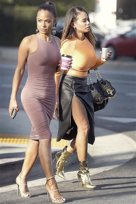 Christina Milian out with her sister - Leather Celebrities